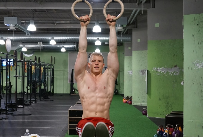 hanging l-sit on rings for abs development