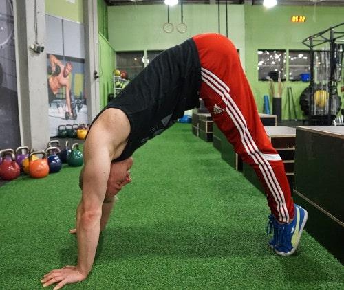 Handstand Push Up Progressions to Build Boulder Shoulders
