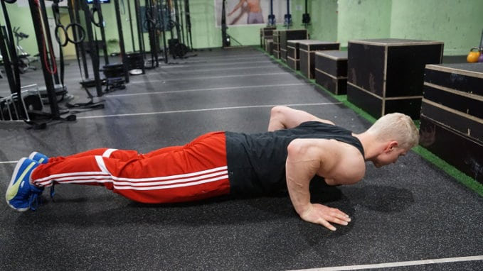 push up bottom position, how much weight do you lift in a push up?