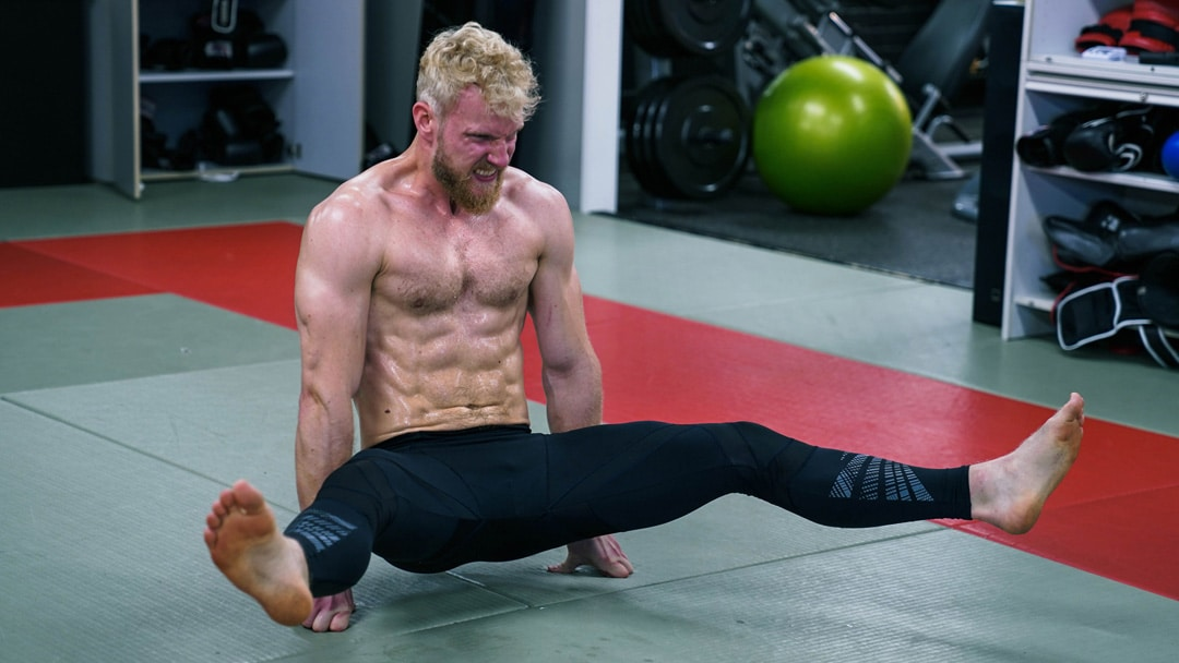 L-sit hold lateral movement glutes